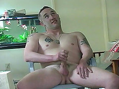 Hot beefy military dude jerking his cock off in here !