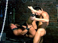 Dominant male spanks and fucks bottom dude in a dungeon !