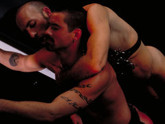 Justin Southhall works over Scott Samson in a down-n-nasty S&M scenario worthy of de Sade himself. Scott, in bondage among two pillars, moans like a good pliant submissive as he is spanked, whipped, spit-on and erotically tortured in any number of cre